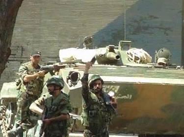 Des soldats de l'infanterie mécanisée syrienne dans une localité d'Al-Hammadyé.