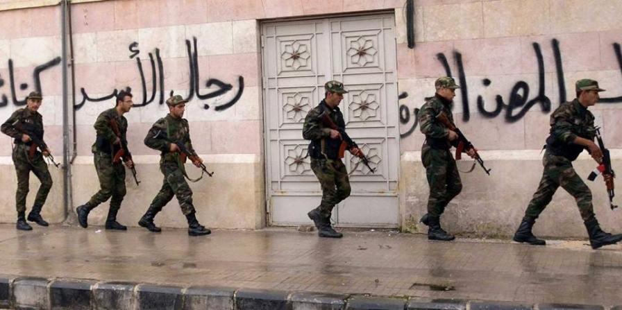 La guerre en Syrie prend de plus en plus la forme d'une guérilla urbaine. Ici, des éléments des forces d'intervention du 11e régiment des troupes de choc dans les rues d'Alep.
